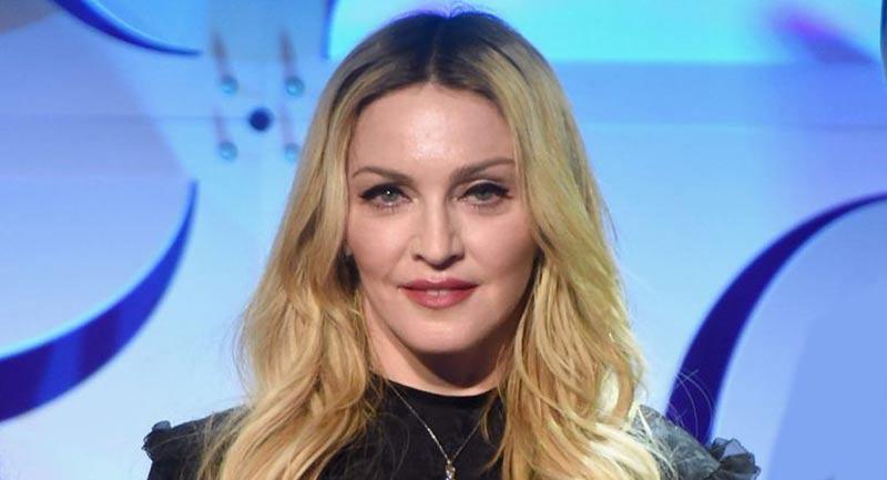 Madonna ya no oculta su amor por Kevin Sampaio